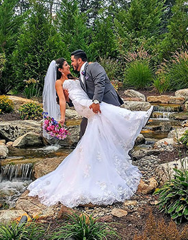nj bride and groom outdoor wedding by waterfall