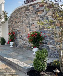 Beautiful Stone Wall With Flowers Outdoor Ceremony Landscaped