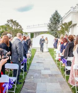 Bride Walking Down Stone Aisle Outdoor Wedding Ceremony With Guests