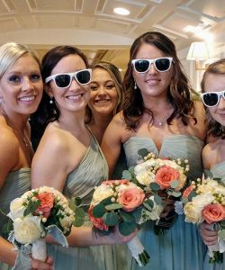 Bridesmaids In Elegant Hallway