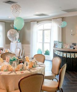 Bright Engagement Party Reception Room With Table Favors