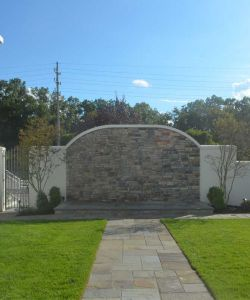 Bright Outdoor New Jersey Wedding Ceremony Venue Stone Wall Backdrop