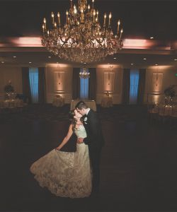 Elegant Bride Kiss Chandeliere Wedding Venue