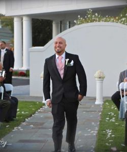 Outdoor Wedding Groom Walking Down Stone Aisle Flower Petals Guests
