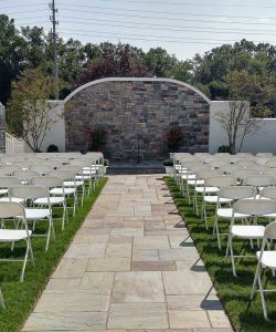 Rustic Elegant Stone Wall Outdoor Wedding Ceremony Landscaped Paver Aisle