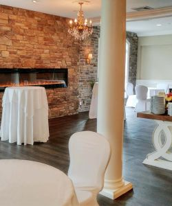 Special Event Reception Room With Stone Wall Fireplace Catering