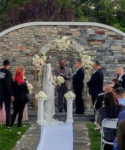 Stone Wall Flowers Outdoor Wedding Ceremony Bride Groom Aisle